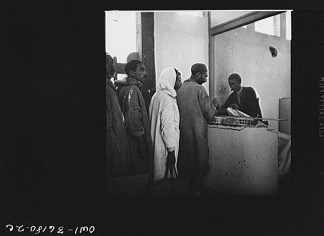 Mejex-El-Bab, Tunisia. A market operated by the Allied civilian relief groups to sell at cost food, clothing, kerosene, etc., supplied by the U.S. Office of Foreign Relief and Rehabilitation Operations to natives and Europeans, victims of war deprivation