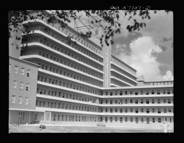 Melbourne, Australia. United States Army hospital. Exterior view of hospital. Towering high above the city is Australia's newest and finest medical structure, built as a civic enterprise as the Royal Melbourne Hospital. Today, renamed the United States Army Fourth General Hospital, it is a healing place for American soldiers and sailors.  A three million dollar lump sum of reciprocal lend-lease was handed over to the United States before it ever had a civilian occupant