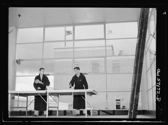 Melbourne, Australia. United States Army hospital. Patients play ping pong in glass enclosed sun room