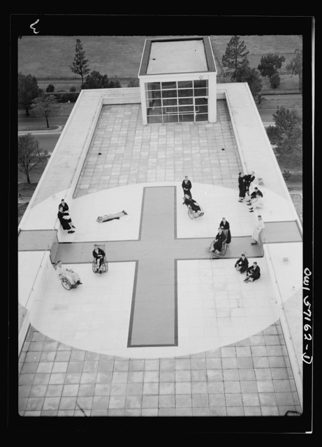 Melbourne, Australia. United States Army hospital. Patients sunning on red cross painted on roof