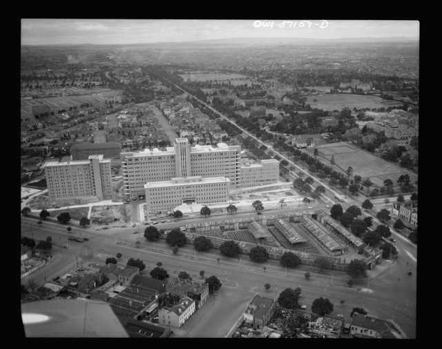 Melbourne, Australia. United States Army hospital.  Towering high above the city is Australia's newest and finest medical structure, built as a civic enterprise as the Royal Melbourne Hospital. Today, renamed the United States Army Fourth General Hospital, it is a healing place for American soldiers and sailors.  A three million dollar lump sum of reciprocal lend-lease was handed over to the United States before it ever had a civilian occupant