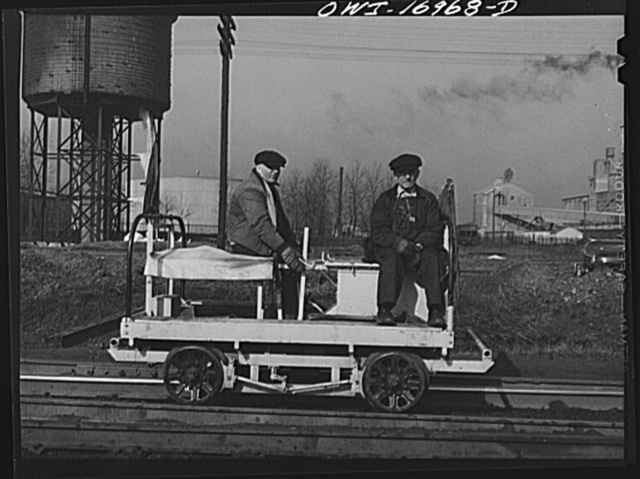 Members of a section crew riding a hand car at an Indiana Harbor Belt Line railroad yard