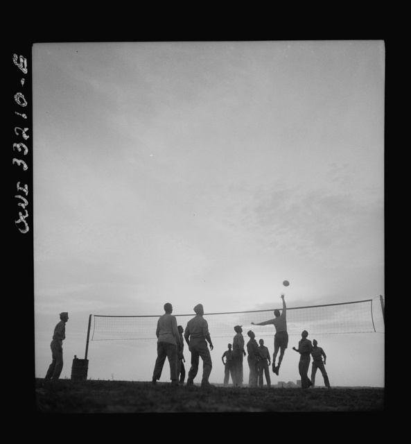 Men of the 57th Fighter Group relaxing with a game of volleyball somewhere in Tunisia