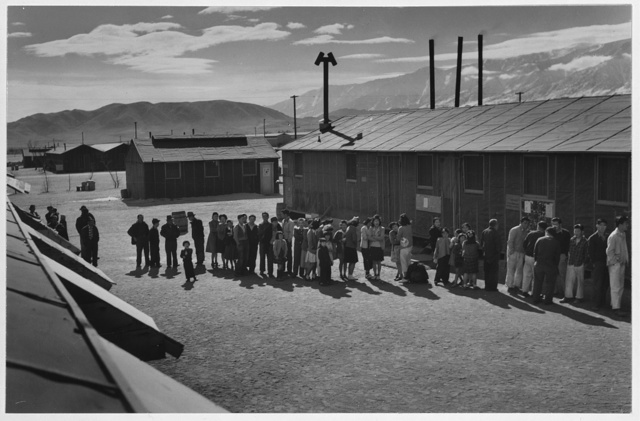 Mess line, noon, Manzanar Relocation Center, California / photograph by Ansel Adams.