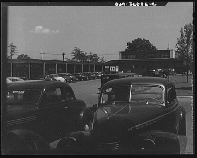 Middle River, a small crossroads in the vicinity of Baltimore, Maryland. FSA (Farm Security Administration) housing project (later National Housing Agency) for Glenn L. Martin aircraft plant workers. Cars parked in shopping center