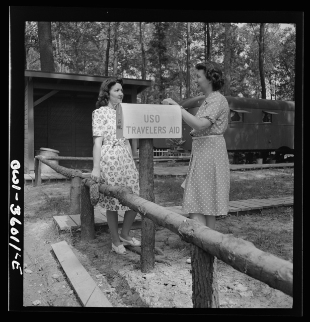 Middle River, a small crossroads in the vicinity of Baltimore, Maryland. FSA (Farm Security Administration) housing project (later administered by the National Housing Agency) for Glenn L. Martin aircraft workers. Mrs. Helen Bird, USO (United Service Organization) traveler's aide, giving information to a newcomer in the Glenn L. Martin trailer village