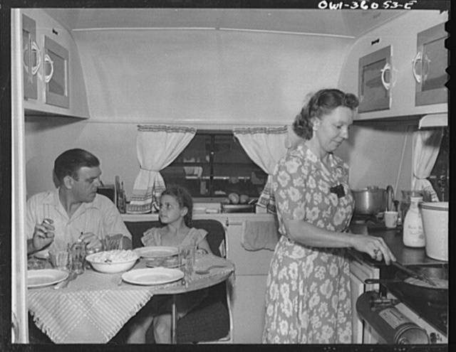 Middle River, Maryland. FSA (Farm Security Administration) housing project for Glenn L. Martin aircraft workers. Mrs. Emma D. Gaw, assistant project service advisor, serving dinner in her trailer home to her husband who works in the Glenn Martin plant and her six year old daughter