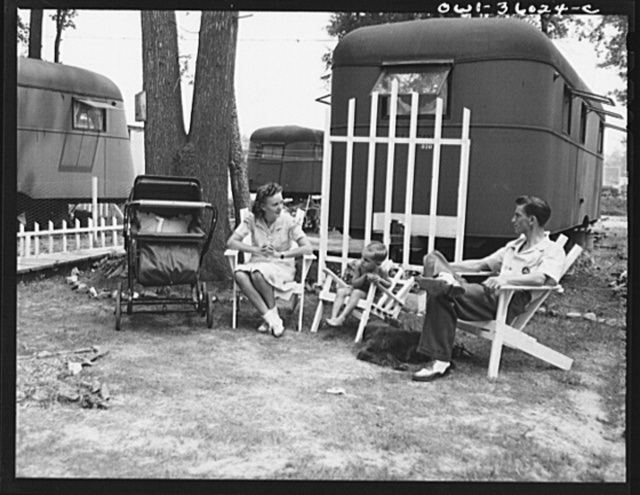Middle River, Maryland. FSA (Farm Security Administration) housing project for Glenn L. Martin aircraft workers. A worker's family in the background of their trailer