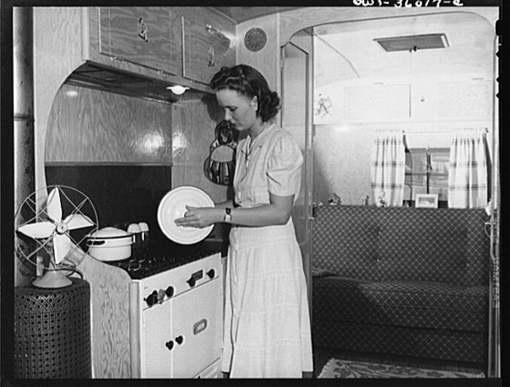 Middle River, Maryland. FSA (Farm Security Administration) project for Glenn L. Martin aircraft workers. Mrs. George Davis preparing dinner in her trailer home