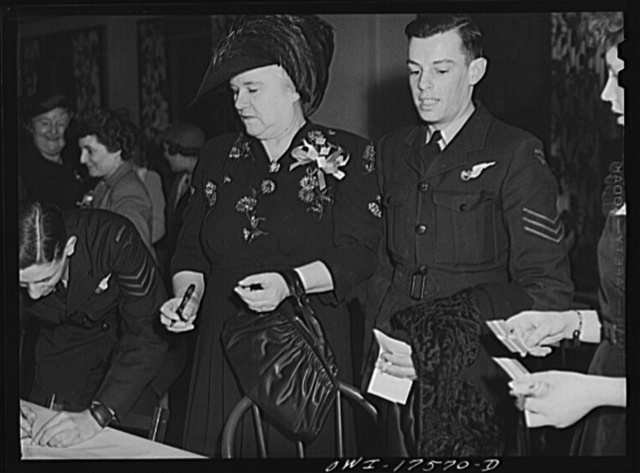 Minneapolis, Minnesota. Sister Kenny at an American Legion meeting at which she was the principal speaker. With her is Sergeant J. Rutherford of Brisbane, a member of the Australian Air Force. He was an honorary guest at the meeting
