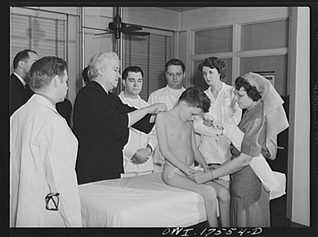 Minneapolis, Minnesota. Sister Kenny conducting a class for doctors and nurses at the Elizabeth Kenny Institute. The patient is Harry Higginbothom of Dallas, Texas