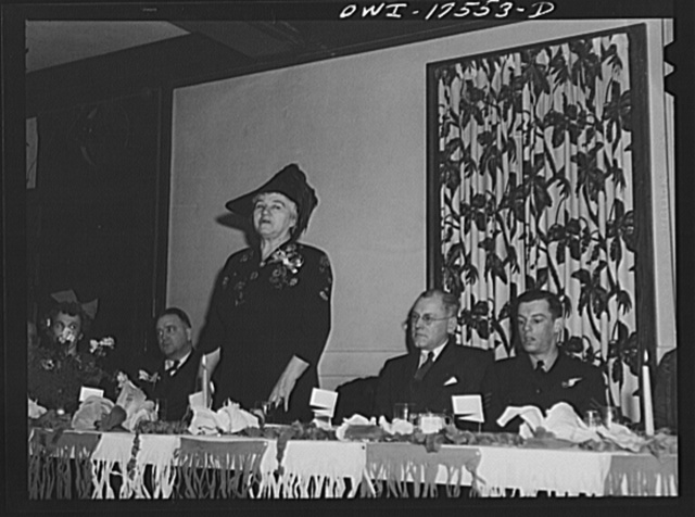 Minneapolis, Minnesota. Sister Kenny of the Elizabeth Kenny Institute addressing a meeting of an American Legion post on infantile paralysis and her contribution towards a new conception of the disease and its treatment, Sitting on the right is Sergeant J. Rutherford, of the Australian Air Force, a guest at the meeting