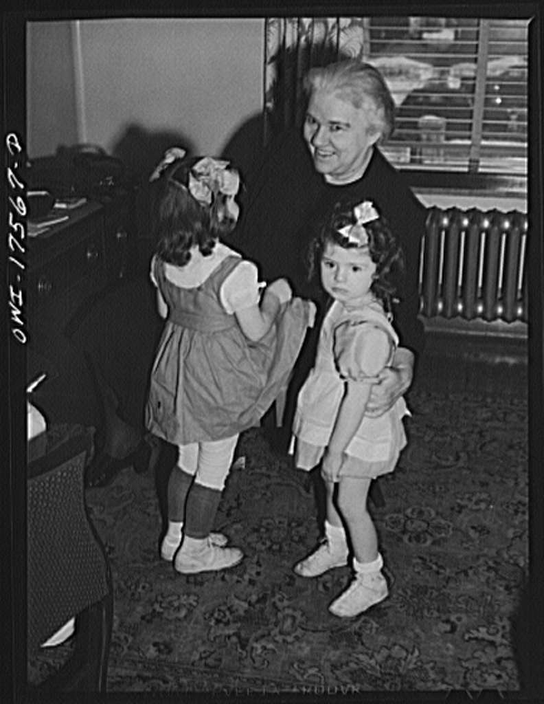Minneapolis, Minnesota. Sister Kenny with Winifred Gorman (right), an infantile paralysis patient, and Winifred's sister who has come to the Elizabeth Kenny Institute to see her on visitor's day