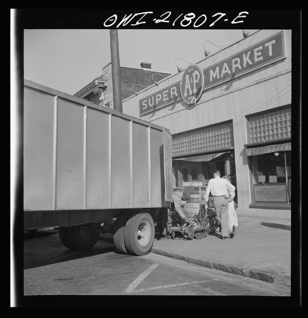 Montgomery, Alabama. Produce truck making deliveries at a supermarket