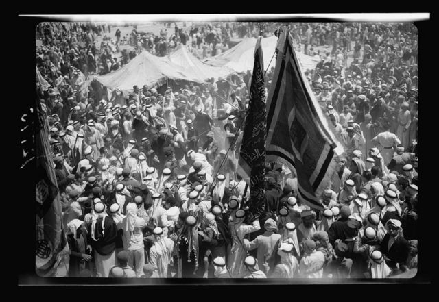 Moslem [i.e., Muslim] celebrations at Mejdal (Wady Nemill and Sey'd Hussein Shrine at Ascalon) and at Gaza (el Muntar) April 20th, 21st and 22nd 1943. Close up of flags and pipers and dancers