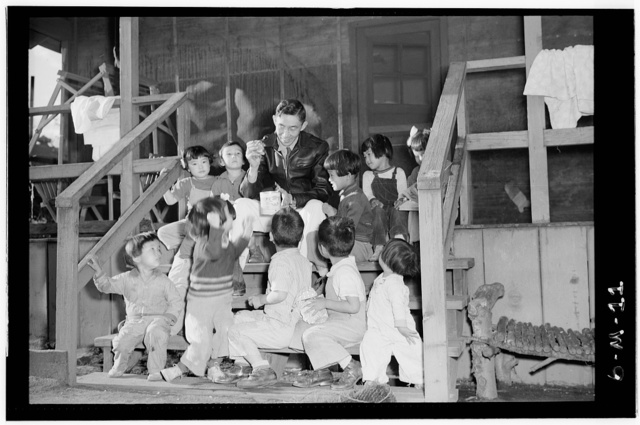 Mr. Matsumoto and group of children / photograph by Ansel Adams.