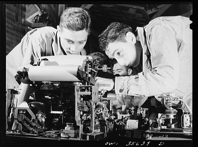Myrtle Beach, South Carolina. Air Service Command. Sergeant Arthur Burtis, left, of 1255 Cook Avenue, Trenton, New Jersey and Corporal Milton Florman, of 1453 Ocean Avenue, Brooklyn, New York, making repairs on a teletype machine at a training center. They will take their place in the signal company of a service group