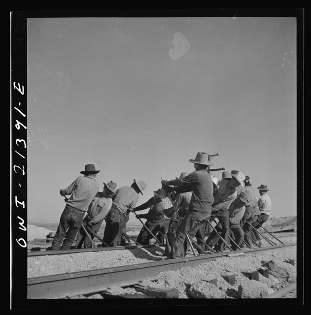 Needles, California. An Indian section gang at work on the tracks in the Atchison, Topeka and Santa Fe Railroad yards