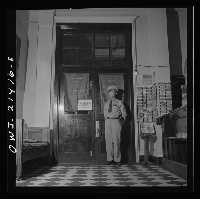 Needles, California. Due to the inability to handle the great crowds on the trains, and because of the labor shortage, the restaurant of the Harvey House at the Atchison, Topeka, and Santa Fe Railroad yard serves only railroad employees