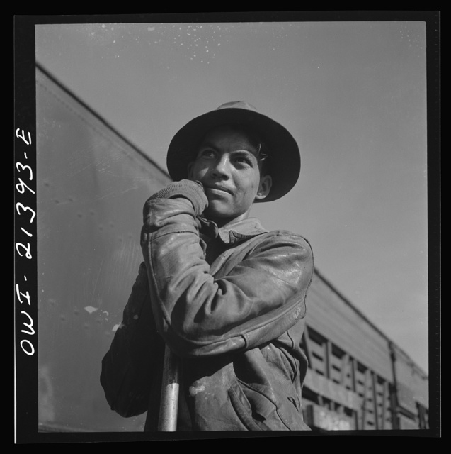 Needles, California. Young Indian worker employed on a section gang working on the tracks in the Atchison, Topeka and Santa Fe Railroad yards