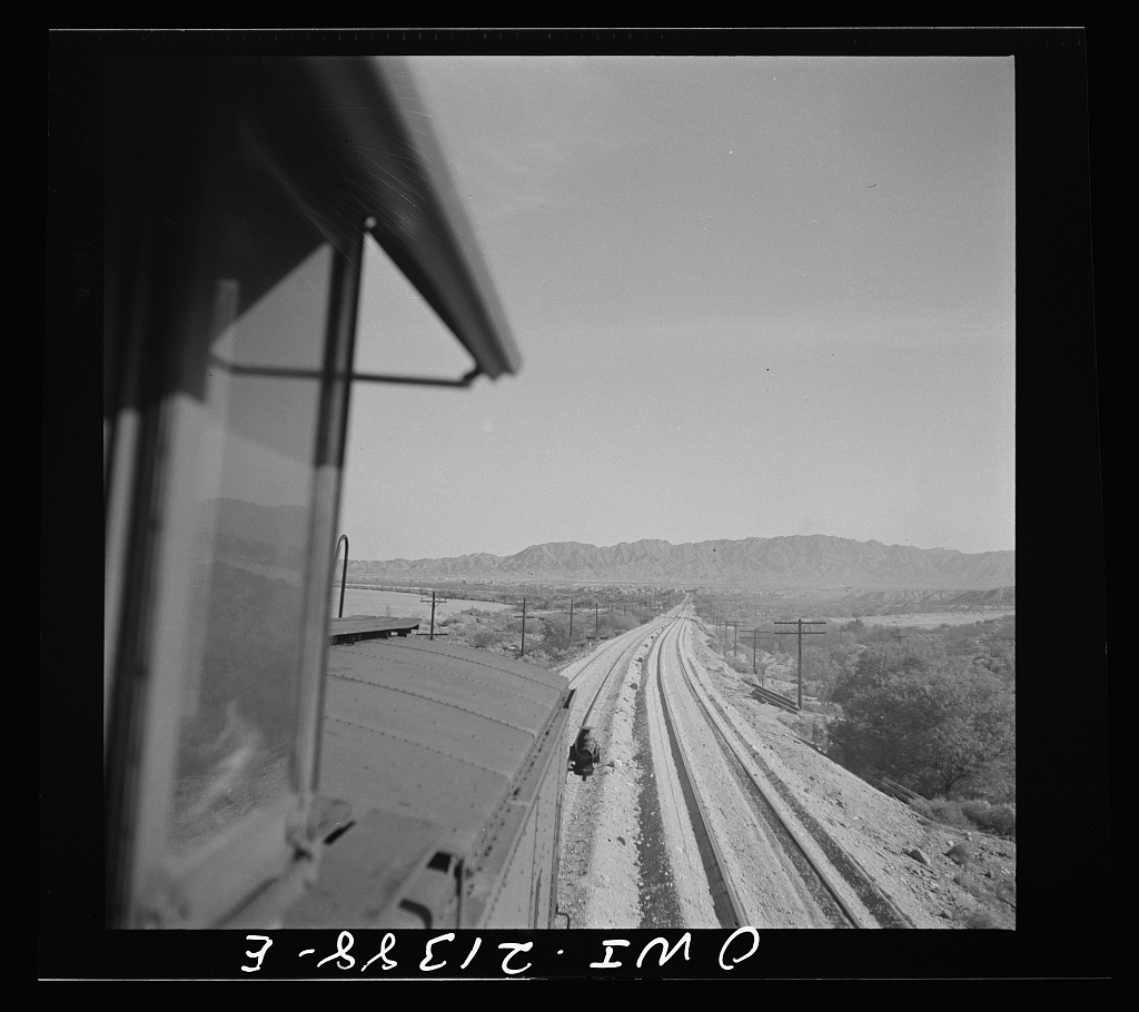 Needles (vicinity), California. Coming across a newly-laid road bed on the Atchison, Topeka and Santa Fe Railroad between Seligman, Arizona and Needles, California