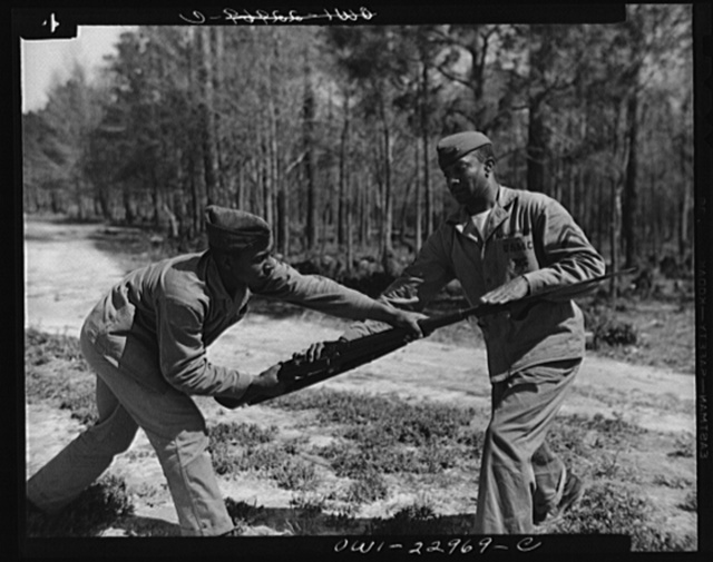 Negro Marines prepare for action. Breaking a tradition of 167 years, the U.S. Marine Corps started enlisting Negroes on June 1, 1942. The first class of 1,200 Negro volunteers began their training three months later as members of the 51st Composite Defense Battalion at Montford Point, a section of the 200 square mile Marine base, Camp Lejeune, at New River, North Carolina. Photo shows Corporal Arvin L. Ghazlo demonstrating to a bayonet class technique of disarming the enemy. Corporal Ghazlo was once teacher of judo to the Georgia State Police