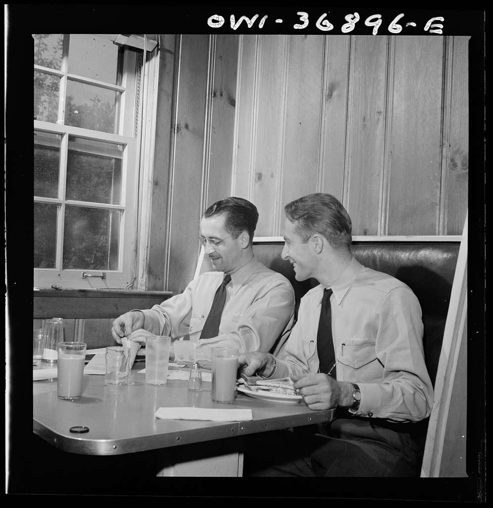New Bedford, Pennsylvania. Drivers of Greyhound buses going from Gettysburg to Pittsburgh, Pennsylvania, checking their tickets while eating lunch at the rest stop