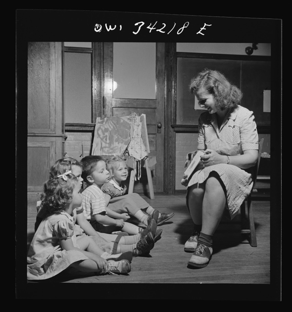 "New Britain, Connecticut. A child care center opened September 15, 1942, for thirty children, ages two through five of mothers engaged in war industry. The hours are 6:30 a.m. to 6 p.m. six days per week. ""Story hour"""