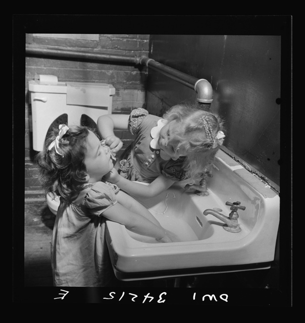 New Britain, Connecticut. A child care center opened September 15, 1942, for thirty children, ages two through five of mothers engaged in war industry. The hours are 6:30 a.m. to 6 p.m. six days per week. Washing up for lunch