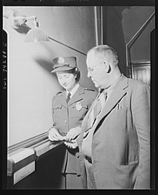 New Britain, Connecticut. Auxiliary policewomen taking fingerprints at the police station