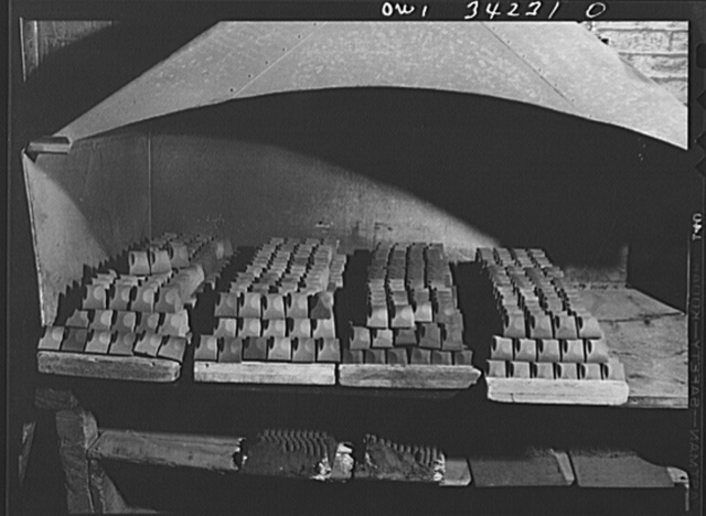 New Britain, Connecticut. Hot cores under a cooling ventilator in the Lander, Frary and Clark plant