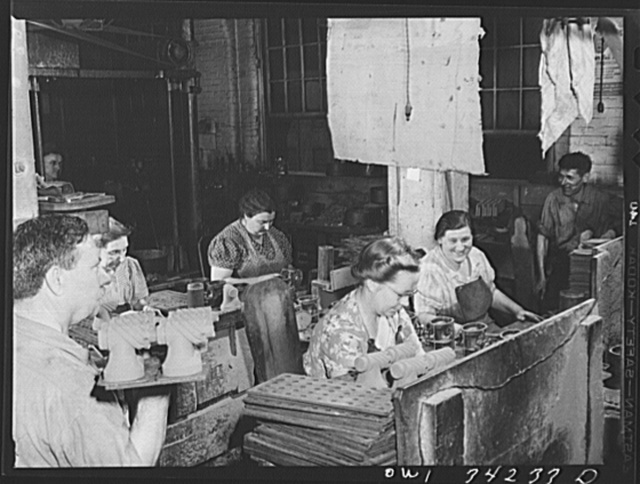New Britain, Connecticut. Women at the Lander, Frary and Clark plant. Processing cores, to be used by the Army for making molds for meat choppers