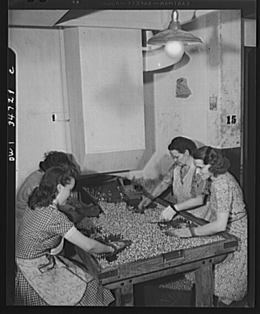 New Britain, Connecticut. Women at the Stanley plant searching for defective bullet jackets