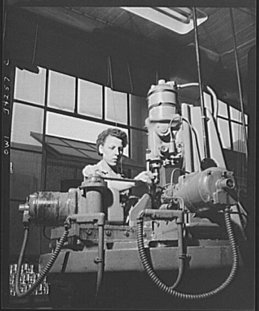 New Britain, Connecticut. Women employed at the Landers, Frary and Clark plant. Drilling holes in bomb fuses