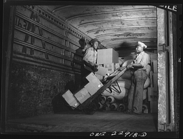 New Orleans, Louisiana. Loading trucks at the Associated Transport Company terminal