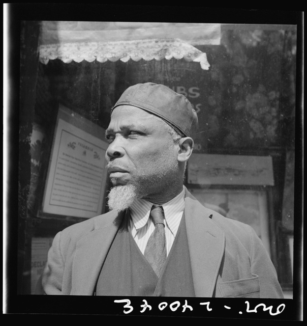"""New York, New York. A follower of the late Marcus Garvey who started the """"Back to Africa"""" movement"""