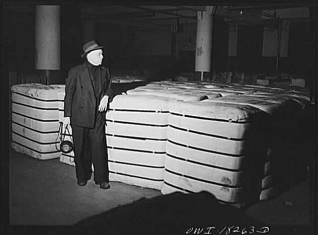 New York, New York. Associated Transport Company trucking terminal on Twenty-third street. Night watchman. This floor is for goods in storage