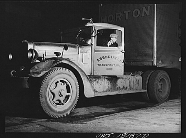 New York, New York. Associated Transport Company trucking terminal on Washington Street. Main line driver backing a truck which he is about to take to Baltimore
