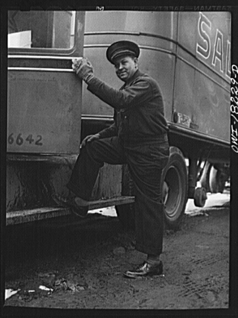 New York, New York. Associated Transport Company trucking terminal on Washington Street. Driver Hunter V. Rhyne getting into the truck which he will drive to Baltimore
