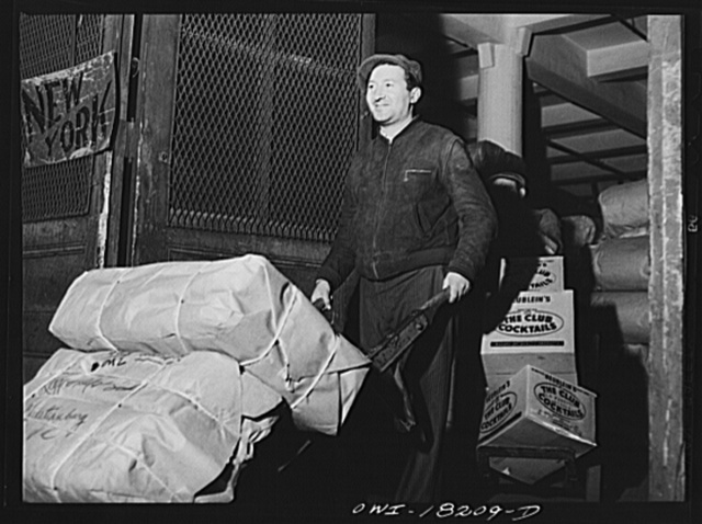 New York, New York. Associated Transport Company trucking terminal on Washington Street. Loading a truck