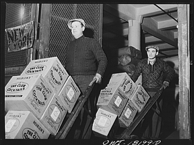 New York, New York. Associated Transport Company trucking terminal on Washington Street. Unloading goods