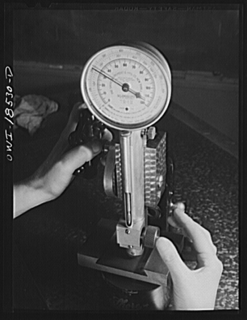 New York, New York. Class in the use of precision instruments, part of the government-sponsored industrial training program at New York University. Most of the students are women. Testing the hardness of an internal dovetail with a shore scleroscope