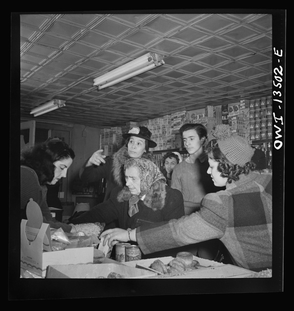 New York, New York. Customers in a grocery store on Mulberry Street. Italian, Jewish and Chinese people live in this neighborhood