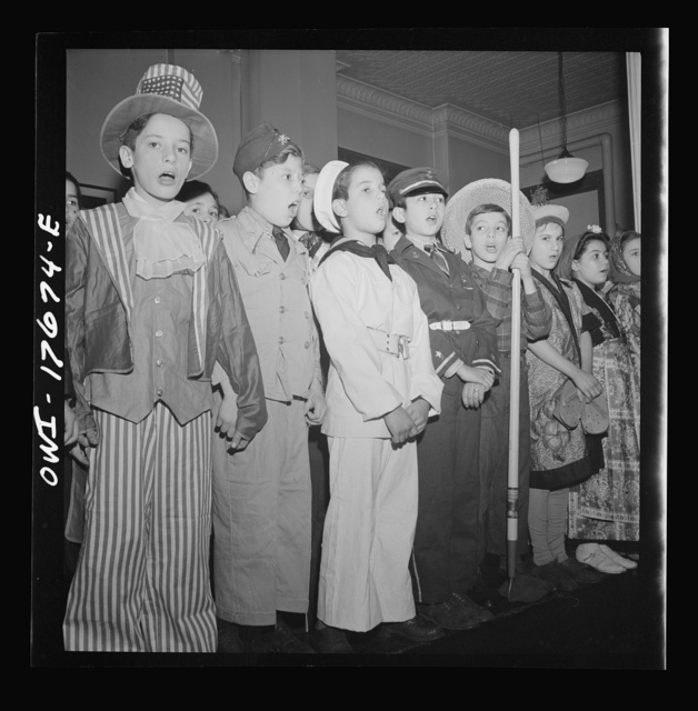 New York, New York finale in a play on America at war, given by students of public school eight in an Italian-American district. Left to right: Uncle Sam, soldier, sailor, Chinese soldier, farmer, housewife