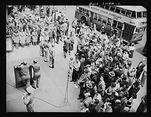 New York, New York. Flag raising ceremony at the Four Freedoms war bond show on the plaza of the International building at Rockefeller center