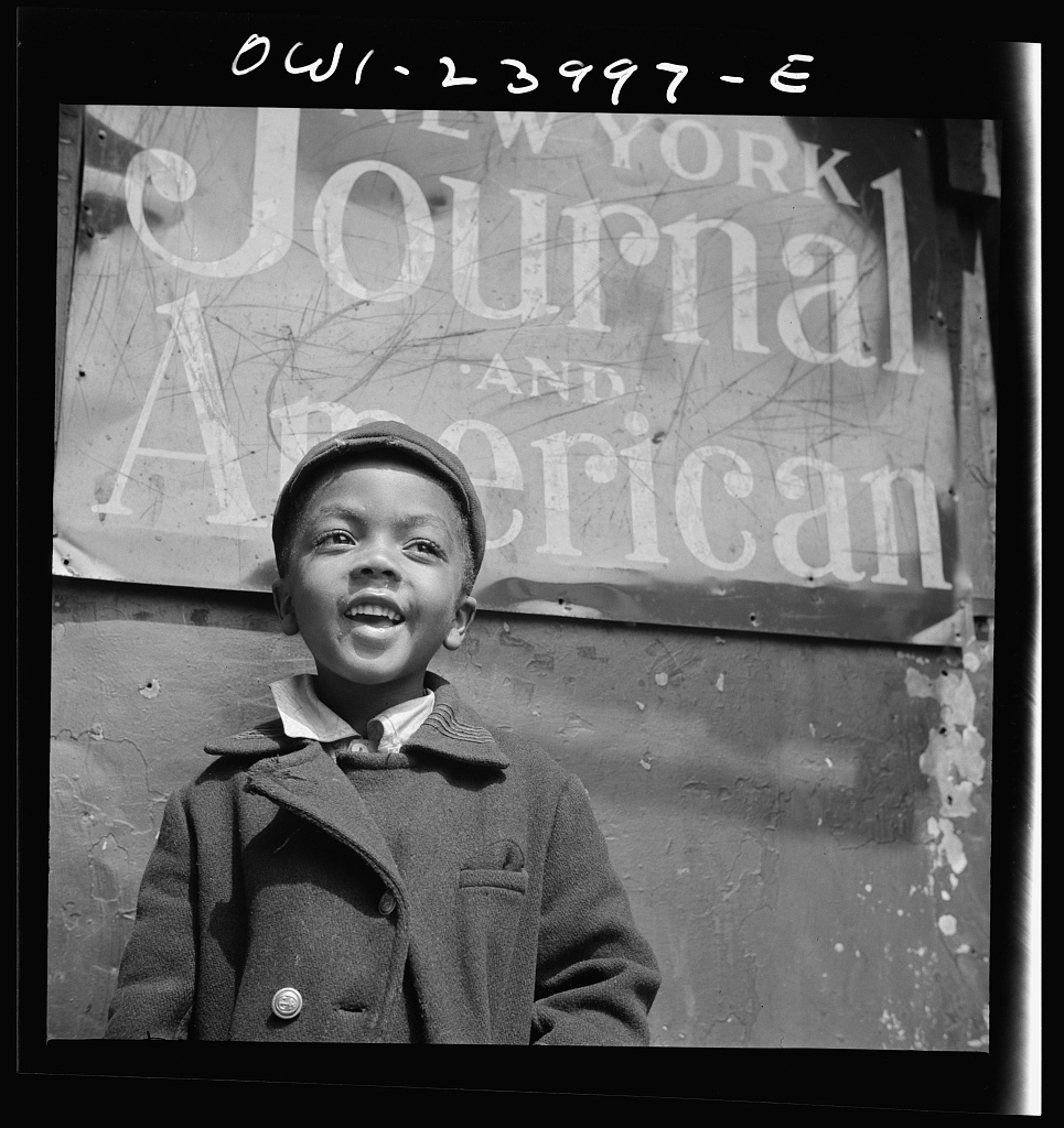 New York, New York. Harlem newsboy
