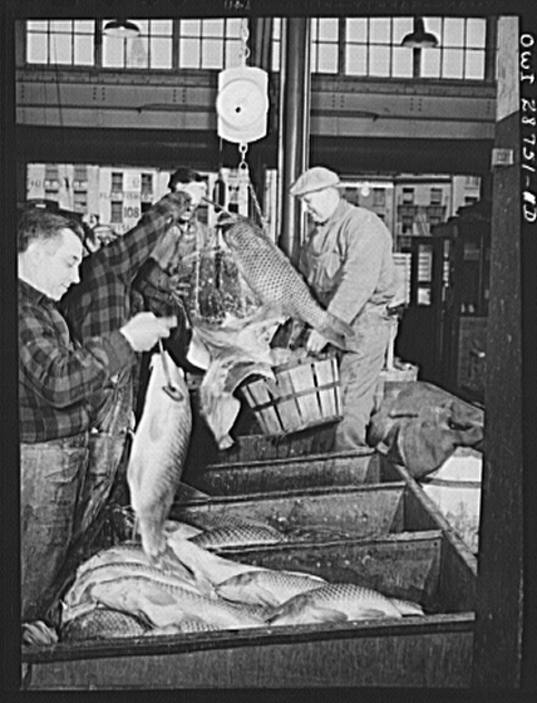 """New York, New York. """"Hookers"""" weighing up cod fish in the Fulton fish market"""