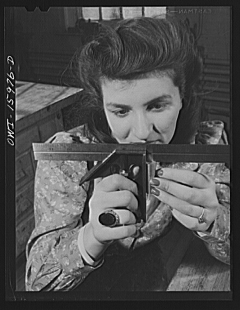 New York, New York. Industrial training for war work offered to women by New York University under United States Government sponsorship. Measuring the right angle of a part for a radio receiver with a T square. This girl formerly studied interior decorating