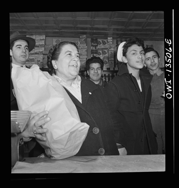 New York, New York. Italian-American customers in a grocery store on Mulberry Street. This woman said she wished her son in Trinidad could see the picture of her