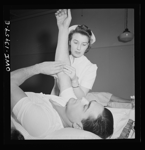 New York, New York. Italian-American fireman giving pint of blood to the Red Cross